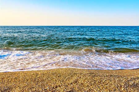 Sandy coast of the Sea of Azov on a summer evening