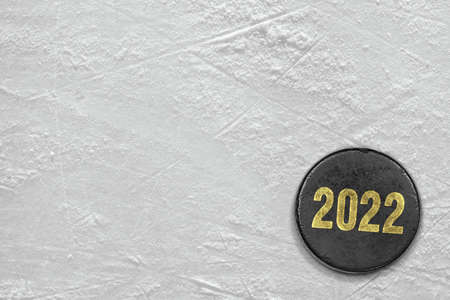 Hockey puck and a fragment of the ice arena. Concept, hockey, season Stock Photo