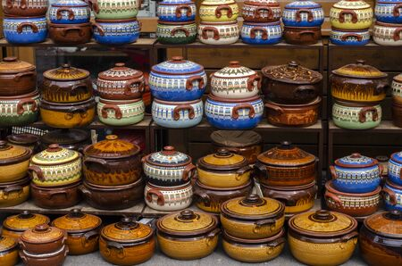 Colorful local crocks for sale every day in the local shopping areas. Stock Photo - 125976611