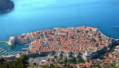 Dubrovnik is a city in southern Croatia fronting the Adriatic Sea. Its known for its distinctive Old Town, encircled with massive stone walls completed in the 16th century. Its well-preserved buildin 写真素材