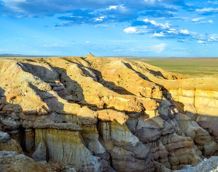 Colorful Cliffs of the Mongolian White Stupa. Its different colors represent different times in its formation history.