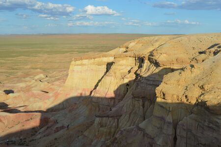 Uneven Cliff Edge of the Mongolian White Stupa 30 meters high and 100 meters wide.