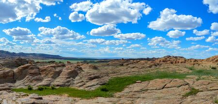 Panorama of Mongolian area known as Little Rock Valley covered with immense flat red-rock formations.