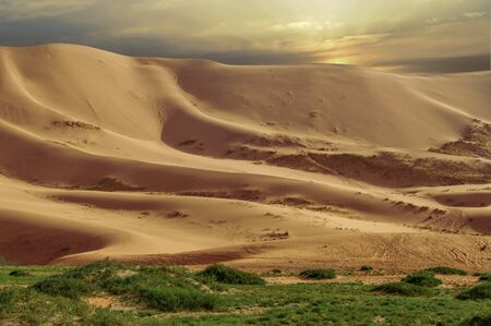 Mongolian Desert Sand Dunes of Close To 350 sq. Miles. This area is great for climbing the dunes to see what is on the other side. Stock Photo