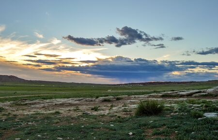 Sunrises On Mongolian Steppes are quiet, serene, and beautiful. Stock Photo