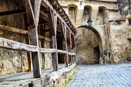 Arch and Wooden Rails In Sighisoara, Romania. Stock Photo