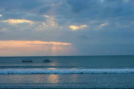 Boats On the Water At Sunset In Kuta Beach, Bali, indonesia
