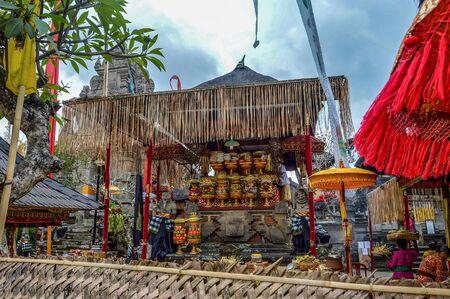 Women Preparing Offerings For Religious Festival in Ubud, Bali, Indonesia Stock Photo