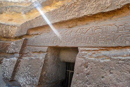 Hieroglyphs Above the Burial Room Entrance Near Pyramids