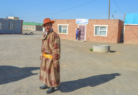 During Naadam Festivals, Mongolians choose to dress in more Traditional Clothing. These Nomads are entrenched in their Mongolian culture. Editorial