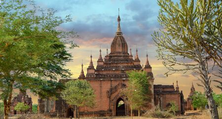 Sunset Shot of Smaller Reddish Temple and Stupa in Bagan, Myanmar