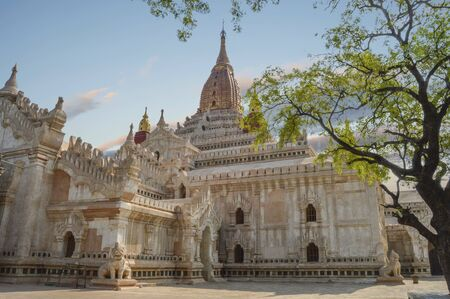 White Ananda Temple In Bagan, Myanmar With Stone Guard Dogs At The Corners