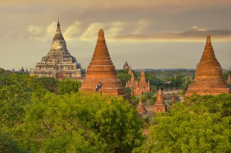 Hsipaw, Myanmar - May 2, 2016 Two Tourists Climb Up Pagoda For Sunset Photos In Bagan Stock Photo