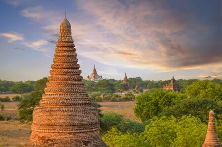 Famous Ananda Temple Is the Backdrop for Red Stupas and Temples At Sunset in Bagan