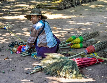Hsipaw, Myanmar - May 7, 2016 Hsipaw Traveling Homemade Brooms Salesman
