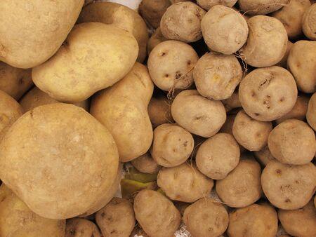 White and Yellow peruvian potato photo