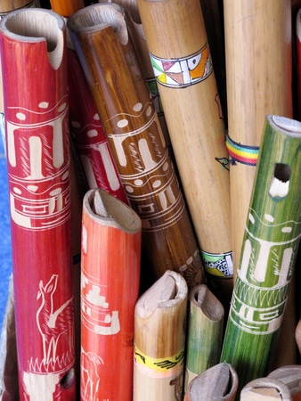 ancient colorful wooden flute photo