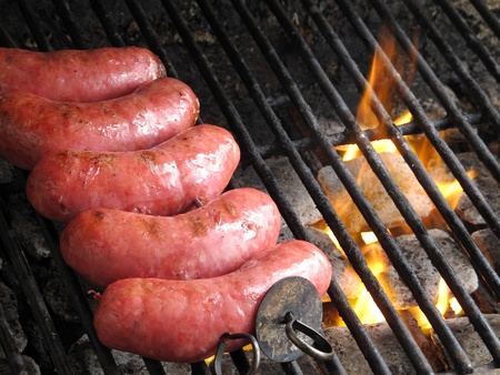 bar b que: grilled sausages on grill, with smoke above it
