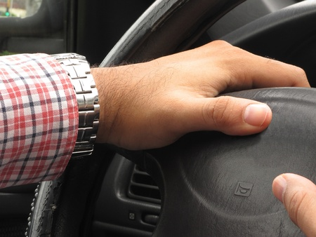 Hands of driver playing the horn photo