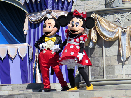 Mickey and Minnie at Cinderella Castle on Magic Kingdom in the day on February 11, 2015 in Orlando - Florida Redactioneel