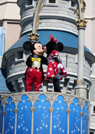 costum: Mickey and Minnie at Cinderella Castle on Magic Kingdom in the day on February 11, 2015 in Orlando - Florida Editorial