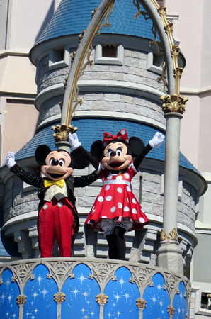 minnie mouse: Mickey and Minnie at Cinderella Castle on Magic Kingdom in the day on February 11, 2015 in Orlando - Florida Editorial