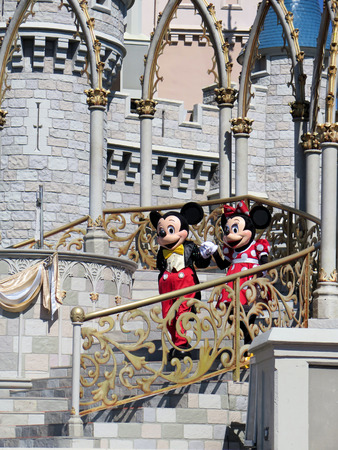 Mickey and Minnie at Cinderella Castle on Magic Kingdom in the day on February 11, 2015 in Orlando - Florida