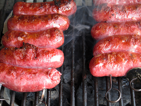 bar b que: Grilled sausages on grill, with smoke above it Stock Photo