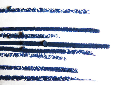 black shadow: close up of a eyeliner pencil drawing on white background Stock Photo