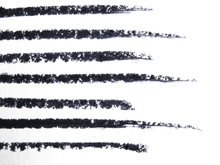 close up of a eyeliner pencil drawing on white background Stock Photo