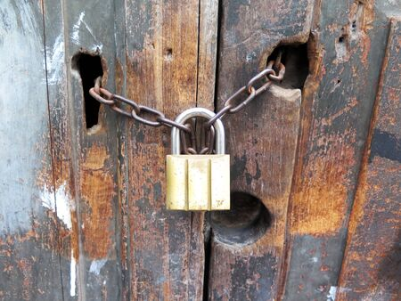 lock and key: Antique key lock chain on wooden door Stock Photo