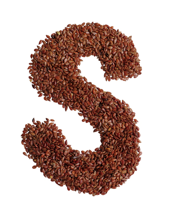 linseed: Letter S made with Linseed also known as flaxseed isolated on white background. Clipping Path included