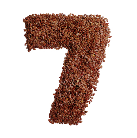 Number 7 made with Linseed also known as flaxseed isolated on white background. Clipping Path included