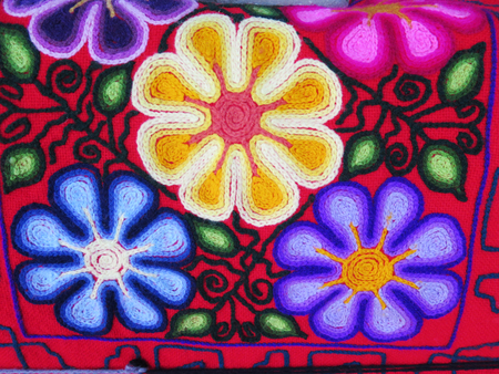 rug texture: Peruvian hand made flower woolen fabric background