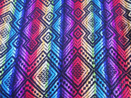 rug texture: Peruvian hand made woolen fabric background