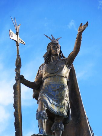 Statue of the Inca Pachacutec over the fountain at the Plaza de Armas in Cuzco, Peru