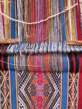 Natural dyed wool yarn in the peruvian Andes at Cuzco Peru Stock Photo