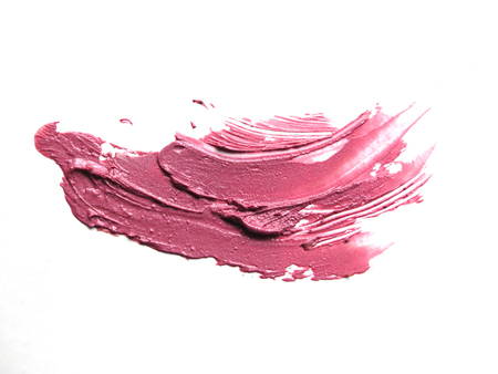 smudged: close up of a smudged lipstick on white background Stock Photo