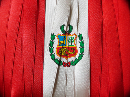 PERUVIAN flag or banner made with red and white ribbons Foto de archivo