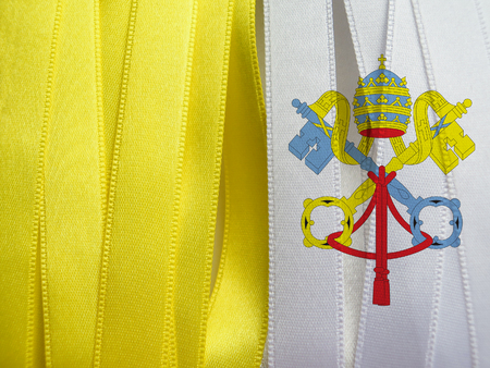 Vatican flag or banner made with Yellow and white ribbons