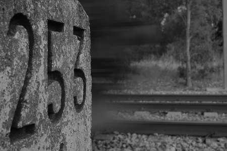 milestone: Milestone and train in a fast movement Stock Photo
