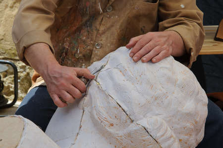 sculptor: sculptor making a sculpture