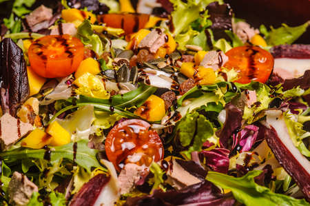 fresh salad with nuts, honey and vinegar