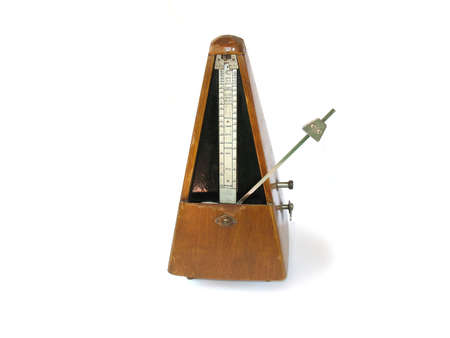 musical metronome on a white background photo