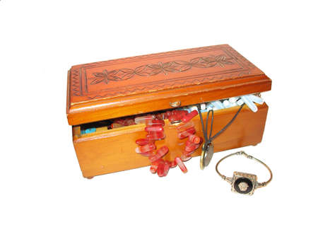 wooden lid: Isolated old casket with beads and bracelet Stock Photo