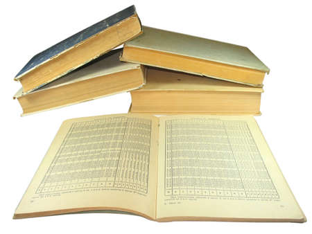 old yellow books with Mathematics tables isolated on white background photo