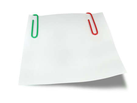 White reminder paper with green and red clips isolated over white background Stock Photo - 3382631