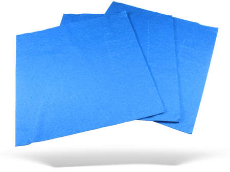 Three blue paper napkins with shadow isolated over white background photo