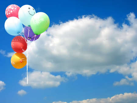 Colored party balloons against blue sky and empty place for your text Stock Photo