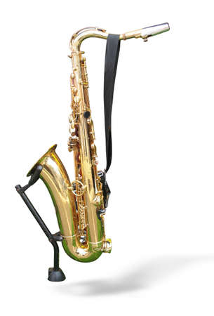 saxy: golden saxophone on a support isolated on a white background